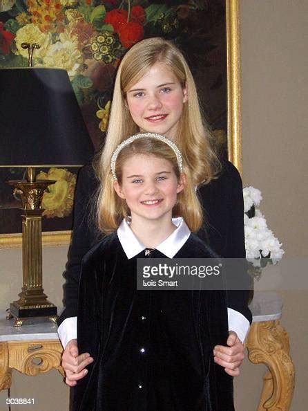 Elizabeth Smart poses for a portrait with her younger